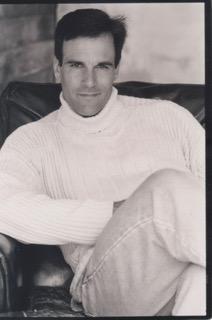 Deke 1990's headshot Turtleneck